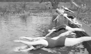 UNITED KINGDOM - APRIL 12: Girls of the Excelsior Club diving in for the start of their club championship race at Kenwood Pond on Sunday, where many swimmers enjoyed the sunshine in the water.' (Photo by Planet News Archive/SSPL/Getty Images)
